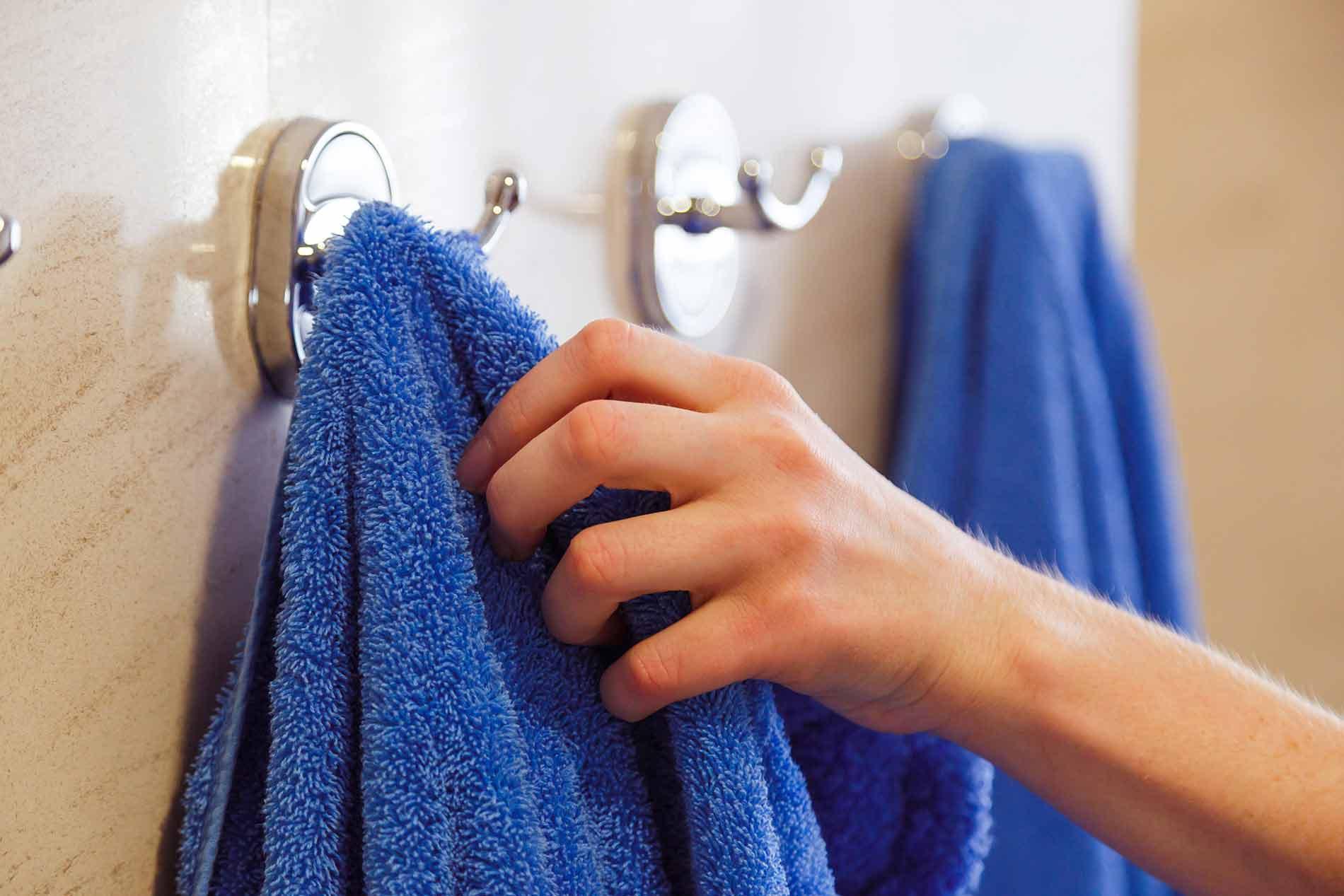 A woman grabbing a towel after using an infrared sauna