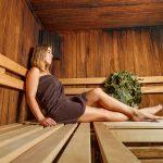 A woman relaxing inside an infrared sauna