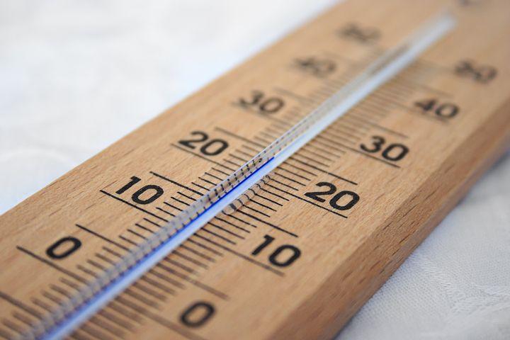 Setting the temperature in an infrared sauna.