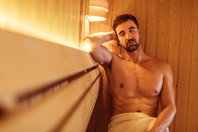 a man enjoying an infrared sauna