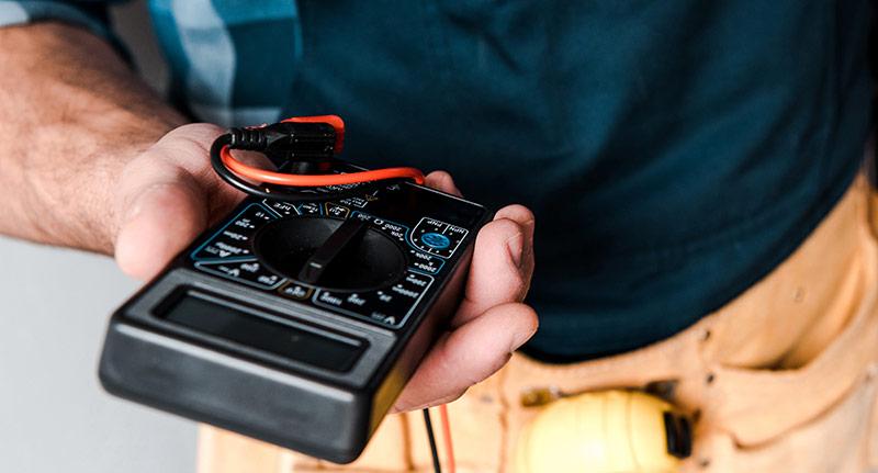 An electrician measuring EMFs